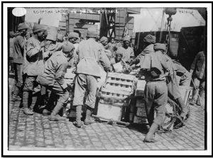 فرقة العمال المصرية في فرنسا (هنا توجد الأحذية والقلنسوات والملابس النظامية)